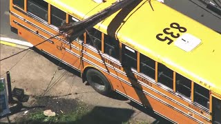 Raw Video: School Bus Crashes Into Pole In Quincy, Bringing Down Wires