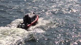 UNITED STATES COAST GUARD MARINE PATROL UNIT ESCORTING STATEN ISLAND FERRY IN NEW YORK HARBOR 1.