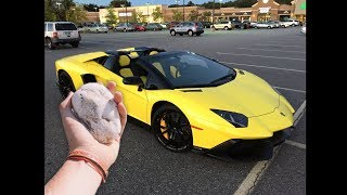 guy throws rock at a lamborghini...