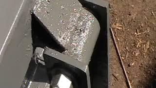 Baixar trailer ramp assist spring. Using a car single leaf spring  . Uses basic parts.