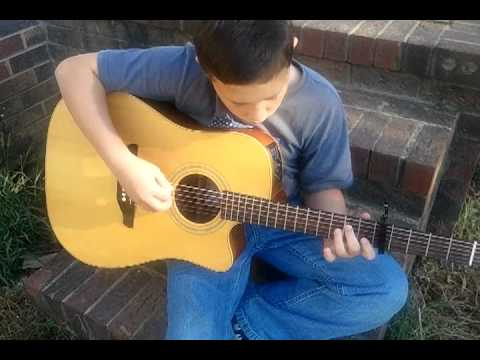 10 year old playing acoustic guitar, Jesus Hold My Hand.