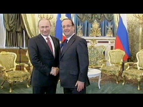 Trade dominates talks on Francois Hollande's first visit to Russia.