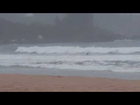 Dude surfing at Ingonish beach