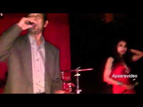 Guest singer Ram Reurn sings a Kbach (Basac style) song at Golden Villa LB