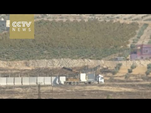 Turkey continues building wall along Syria border to prevent Kurdish incursions