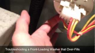 troubleshooting an overfill problem in a front loading washing machine