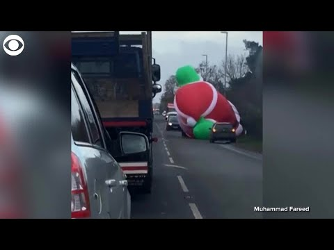 A.J. - Giant Inflatable Santa Creates Havoc On A Busy Highway!