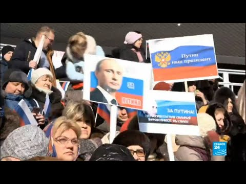 Paid to cheer the president: Putin's unorthodox election campaign