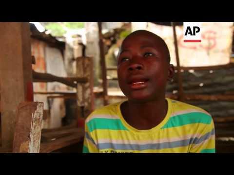 Streets quiet, German aid workers help street children on third day of Ebola lockdown