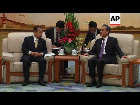 Japan's ruling party secretary general meets China FM Wang Yi
