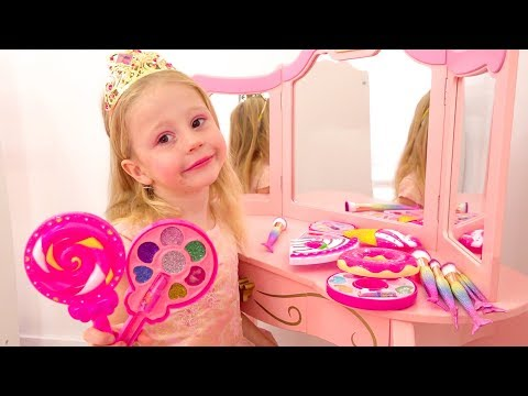Nastya playing with make up toys and dress up