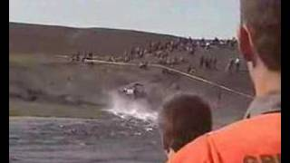 A car driving over a river in Iceland Video