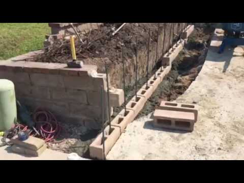 Short Retaining Block Wall Preparation By Crown