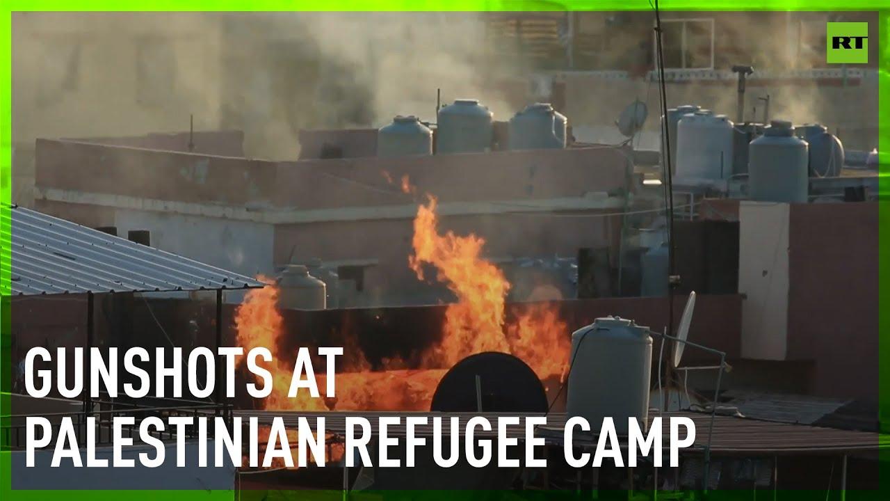 Gunshots and smoke billow over Palestinian refugee camp in Lebanon