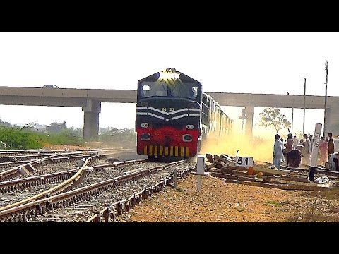Bolan Mail Express Passing Like A Storm With Ziang Catterpillar Locomotive