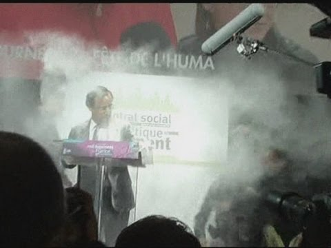 protester-throws-flour-over-french-presidential-hopeful-francois-hollande