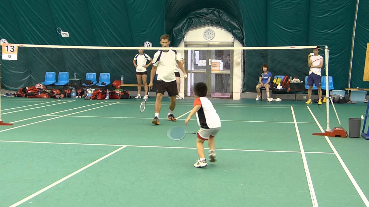 year old boy exchanging badminton playing skills swiss  5 year old boy exchanging badminton playing skills swiss team