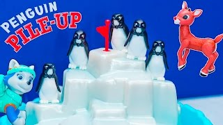 Playing Penguin Pile Up Game with Paw Patrol Everest against Rudolph Toys