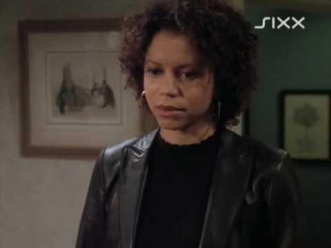 Gloria Reuben in a leather jacket