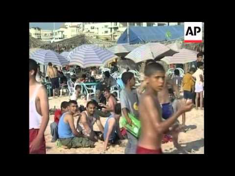 Crowds flock to Gaza beaches to escape life under Israeli blockade