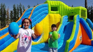 Kids pretend play easter egg and Inflatable water slide, for kids video