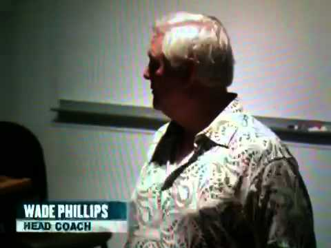 Wade Phillips talks to his team