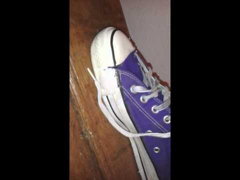 worn out purple Converse Chuck LowTop