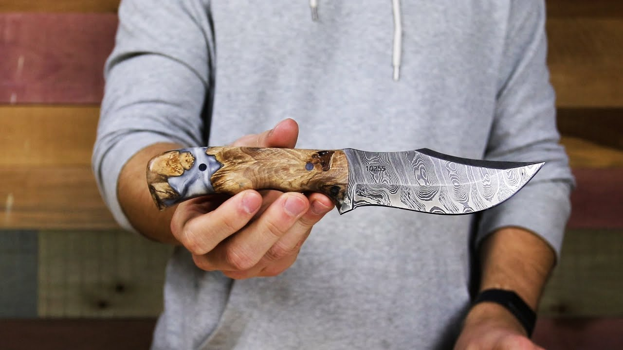 Carved Hunting Knife Damascus Blade Wood Resin Handle On Display