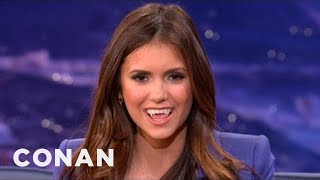 Nina Dobrev Shows How To Make The Sexy Vampire Face - CONAN on TBS(Nina Dobrev makes a sexy vampire face! Conan... not so much., 2012-05-10T14:15:22.000Z)