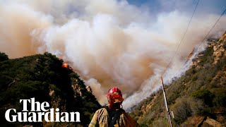 California wildfires: rescuers search for victims as winds fuel flames thumbnail
