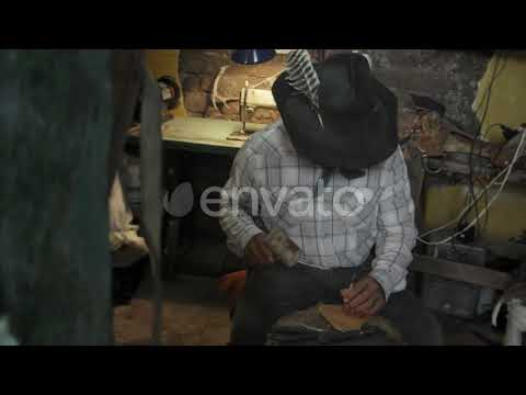 23590572 Leather Artisan Working By Suiteglobal Preview 1
