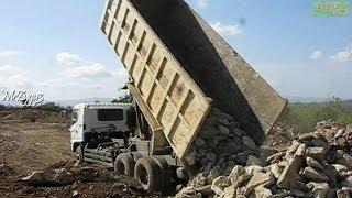 Dump Truck Hino FM260TI Unloading Rocks