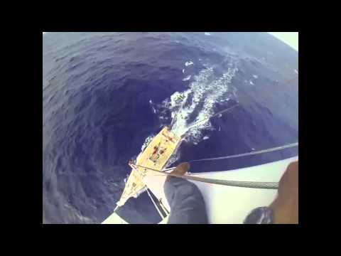 Climbing to the top of the mast of a Clipper Race yacht mid Atlantic Ocean