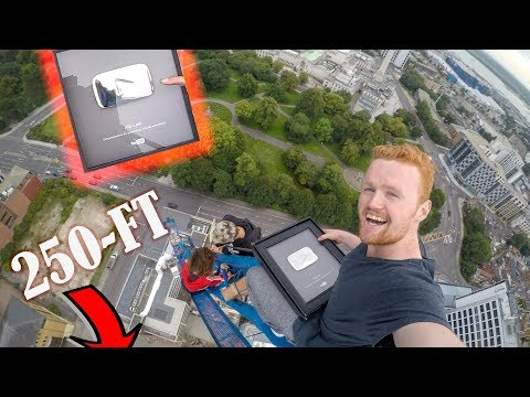 UNBOXING 100K PLAY BUTTON ON TOP OF CRANE!!