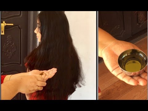 Homemade Herbal hair oil  for healthy long black thick hair. To treat dandruff and hair fall problem
