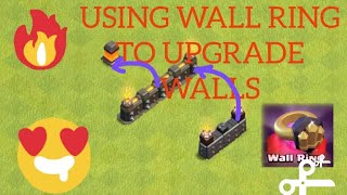 UPGRADING WALLS WITH WALL RINGS RECEIVED FROM TRADER FOR GEMS IN CLASH OF CLANS .