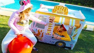 Ali and Adriana play with food toy truck