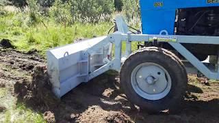 Работа бульдозерного отвала по целине в связке с полугусеничным ходом трактора мтз