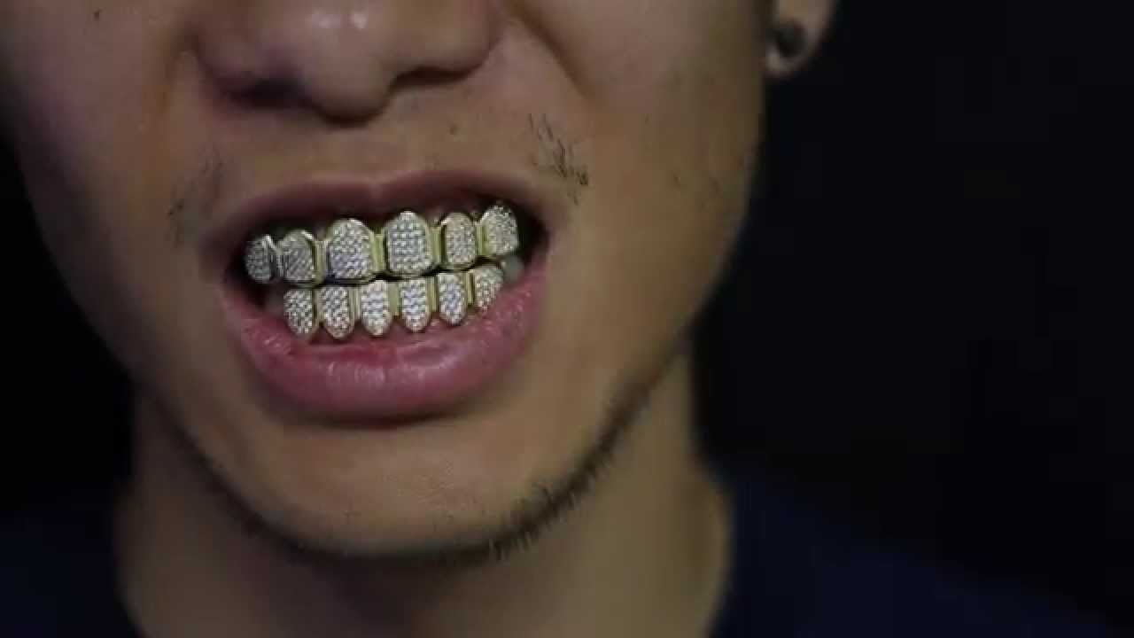 Custom Gold Grillz - 18k Gold Diamond Teeth Grillz - YouTube c387bd703064