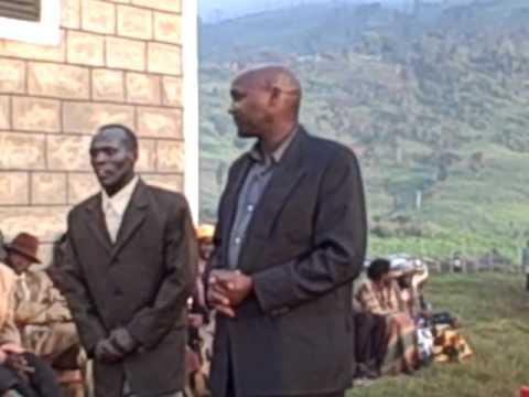 Piswa, Uganda; Moses and Alex thank FH Staff