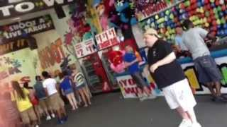 Artie Lange at the Jersey Shore shooting hoops to win a prize