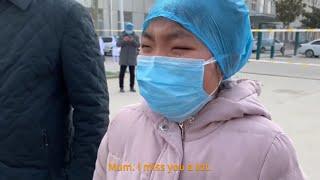 "Chinese nurse in coronavirus-hit hospital gives her sobbing daughter ""air hug"""
