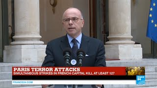 French interior minister on Paris Attacks: investigation and manhunt for suspects continuing