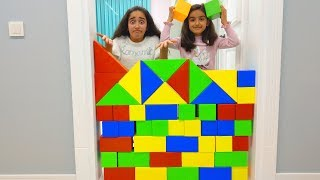 Kids playing with colorful toy bricks
