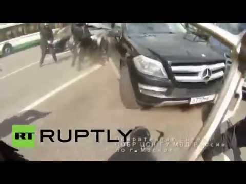 Thrilling GoPro footage: GTA style car chase & shootout with $7 million robber gang in Moscow
