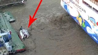 Tug boat pushed under water by cruise ship