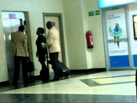 Air Uganda Cabin Crew at Entebbe Airport Arrival hall.avi