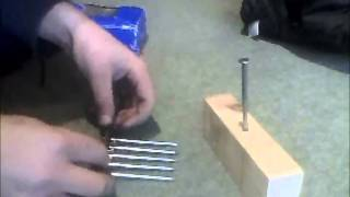 How to balance 12 nails on 1