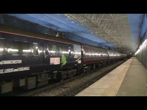 DRS Class 47 810 and 47 828 depart Edinburgh with the Cruise Saver Express ECS