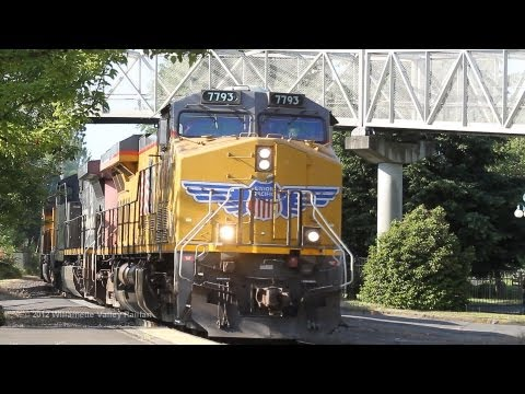 UP 7793 leads QPDRV past the Salem, Oregon Amtrak station on 7-5-2012